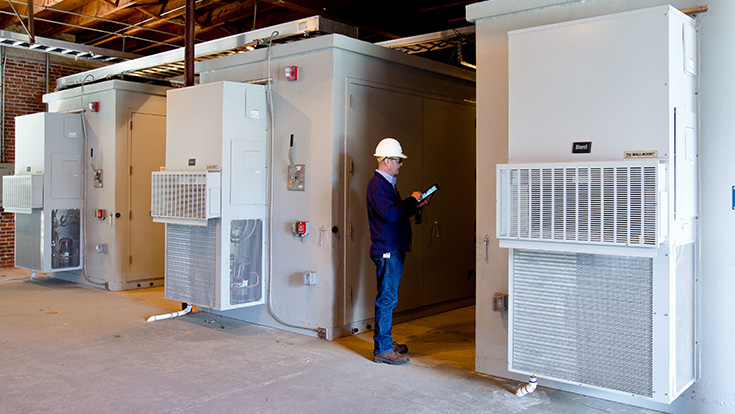 Engineer monitoring NextEra Energy Resources energy storage systems